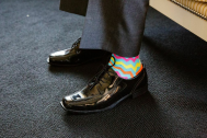 Andrew and his groomsmen brightened things up with some funky socks - Photo by Joe Foley Photography
